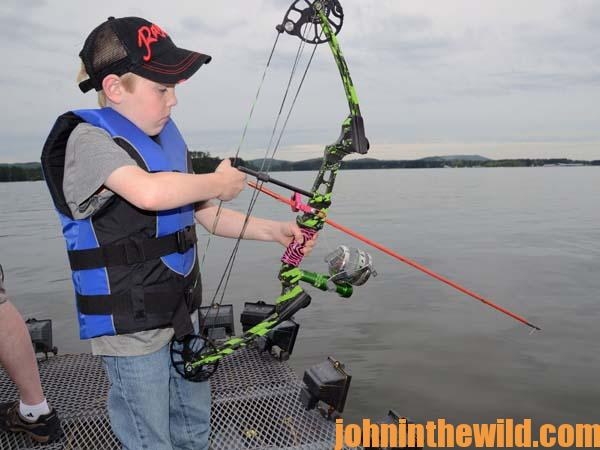 Mark land loves to shoot carp tournaments with his bow for Bow fishing rod