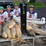 A Bowfishing Team Takes a Monster Grass Carp While Bowfishing