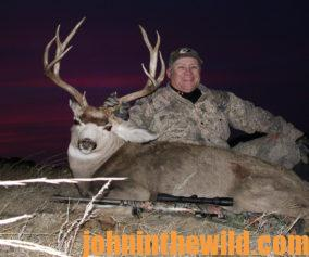 Hunter with a downed deer