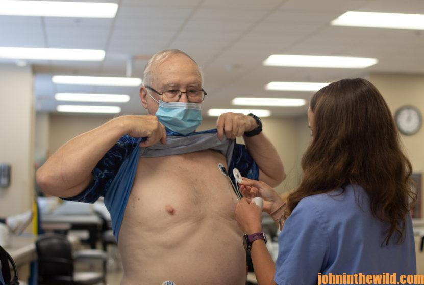 John E. Phillips being hooked up to a heart monitor