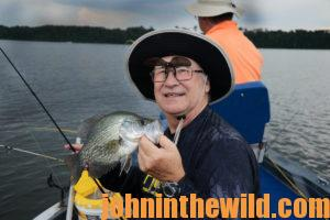 John poses with a fish