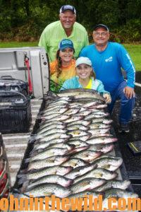 Everyone poses with the fish they caught from the bad-weather fishing trip