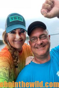 Amie Pollard and her husband Ron smile for a photo
