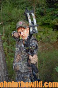 A hunter takes aim with his bow