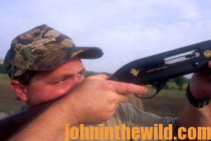 A hunter takes aim with his rifle