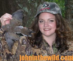 A hunter with her downed bird