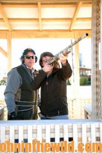 Two sharpshooters practice at the range wearing protective eyewear and ear protection