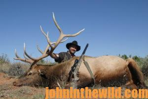 A hunter poses with his downed elk