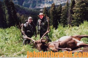 Two hunters with a downed elk