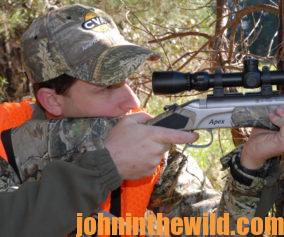 Hunter aims with his rifle
