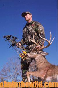 A hunter recovers his downed deer