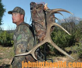 A hunter packing out an elk